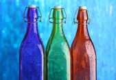 Colorful bottles on bright background — Stock Photo