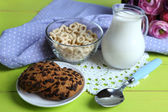 Homemade yogurt and delicious  cereals in bowl on wooden table background. Conceptual photo of healthy and tasty breakfast — Stock Photo