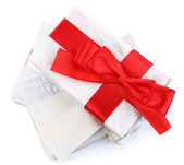 Beautiful gifts with ribbons, isolated on white — Stock Photo