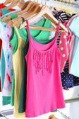 Different clothes on hangers close up — Stock Photo
