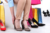 Young woman trying on shoes in shop — Stock Photo