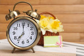 Alarm clock on table, on wooden background — Stock Photo