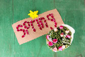 Romantic spring letters made of pink petals, on wooden background — Stock Photo