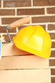 New bricks and building tools on brick wall background — Stock Photo