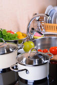 Pots on stove in kitchen — Stock Photo