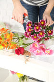 Female hands composing beautiful bouquet, close-up. Florist at work. Conceptual photo — Stock Photo