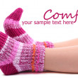 Female legs in colorful socks, isolated on white — Stock Photo #43897661