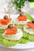 Delicious canapes on table close-up — Stock Photo