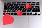 Red hearts on computer keyboard close up — Foto Stock