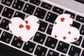 Bright hearts on computer keyboard close up — Stock Photo