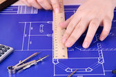 Architectural project with female hands, close up — Foto Stock
