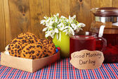 Tasty herbal tea and cookies on table — Foto Stock