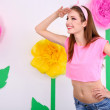 Beautiful young woman on decorative background — Stock Photo #43900379