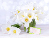Beautiful bouquet of white tulips on table on light background — Stockfoto