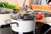 Pots on stove in kitchen — Stockfoto