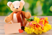 Bear toy on table on bright background — Stock Photo