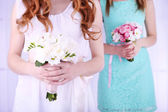 Woman hands holding beautiful wedding bouquet — Stock Photo