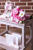 Beautiful wedding still life with  bouquet on bricks wall background — Stock Photo