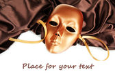Mask on brown fabric — Stock Photo