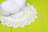 White yarn for knitting with napkin and spokes on wooden table close-up — Stock Photo