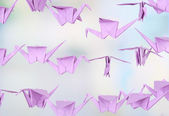 Origami cranes on light background — Stock Photo