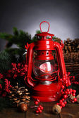 Red kerosene lamp on dark background — Stock Photo