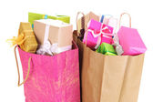 Presents in paper bags isolated on white — Stock Photo