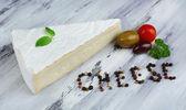 Tasty Italian cheese on wooden table — Photo
