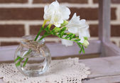 Beautiful freesia flowers in vase — Stock Photo