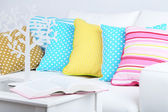 White sofa with colorful pillows in room — Stock Photo
