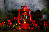 Red kerosene lamp on dark natural background — Stock Photo