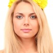 Beautiful young woman with bright yellow flowers in her hair on white background close-up — Stock Photo