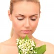 Beautiful young woman with a bouquet of lilies of the valley on white background close-up — Stock Photo #44183485