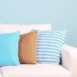 White sofa close-up in room on blue background — Stock Photo #44183971