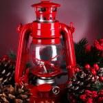 Red kerosene lamp on dark color background — Stock Photo #44184425