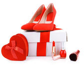 Beautiful red female shoes, gift box and cosmetics, isolated on white — Foto de Stock