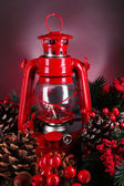 Red kerosene lamp on dark color background — Stock Photo