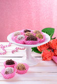 Set of chocolate candies on table on pink background — Stock fotografie