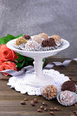 Set of chocolate candies on table on grey background — Stock Photo