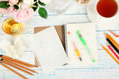 Composition with notebook and pencils on wooden table close-up — Stock Photo