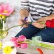 Female hands composing beautiful bouquet, close-up. Florist at work. Conceptual photo — Stock Photo #44190909