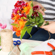 Female hands composing beautiful bouquet, close-up. Florist at work. Conceptual photo — Stock Photo #44191025