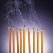 Smoke and extinct candles on dark background — Stok fotoğraf #44324537