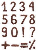 Kahve numaraları üzerinde beyaz izole — Stok fotoğraf