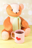 Bear toy on table on light background — Stock Photo
