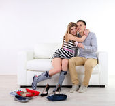 Loving couple choose new shoes, on light background — Stock Photo