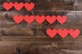 Paper hearts on wooden background — 图库照片