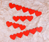 Paper hearts on paper background — Stock Photo