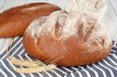 Rye breads on napkin on table close up — ストック写真
