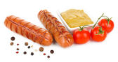Grilled sausages with tomatoes and mustard isolated on white — Stock Photo